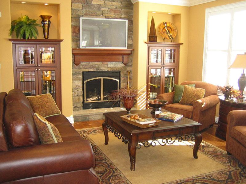 Мебель с камином в интерьере гостиной фото